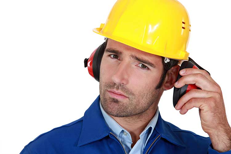 Man removing his earmuff to communicate
